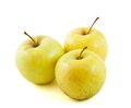 Three Golden delicious apples Royalty Free Stock Images
