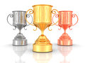 Three Golden, Silver, Bronze Winners Trophy Cups On White Backgr Royalty Free Stock Photo