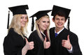 Three graduates a group of with a thumbs up sign isolated on white Royalty Free Stock Photos