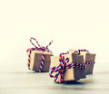 Three handmade gift boxes in shiny colour background.