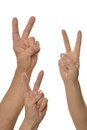 Three hands fingers victory sign isolated on a white background Stock Photo