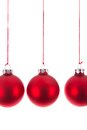 Three hanging Christmas balls at a white background Royalty Free Stock Photo