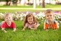 Three happy children lying on the grass Royalty Free Stock Photo