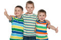 Three happy cute boys cheerful are standing together on the white background Royalty Free Stock Image