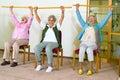 Three happy elderly ladies doing exercises Royalty Free Stock Photo
