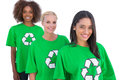 Three happy enviromental activists standing in a row Royalty Free Stock Image