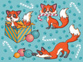 Three happy foxes at christmas time playing with festive items Royalty Free Stock Photography