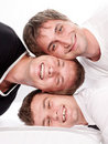 Three happy friends having fun on a white Stock Photo