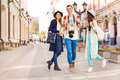 Three happy friends walking during sightseeing on the european street summer day time in moscow Stock Photo