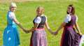 Three happy girls in Dirndl Stock Photos
