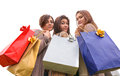 Three happy girls doing shopping group of make with colored bags Royalty Free Stock Photography