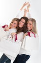 Three happy shoppers Royalty Free Stock Images
