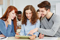 Three happy students learning class tablet pc classroom Royalty Free Stock Photo