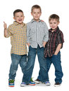 Three happy young boys group of cheerful are standing together on the white background Stock Images