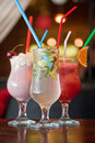 Three healthy nonalcoholic cocktails set of berries and classic mohito Royalty Free Stock Photo
