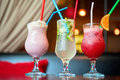 Three healthy nonalcoholic cocktails set of berries and classic mohito Royalty Free Stock Photos