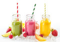 Three healthy smoothies with fresh tropical fruit Royalty Free Stock Photo