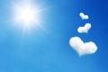 three heart shaped cloud on blue sky with sunshine