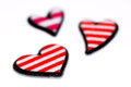 Three hearts closeup valentines day background with small red and white striped Stock Image