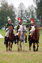 Three horse riders at Borodino battle historical reenactment in Russia Royalty Free Stock Photo