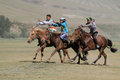 Three horses racing kharkhorin mongolia july horse during naadam midsummer festival on july in kharkhorin mongolia naadam is Stock Photos