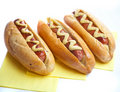 Three hot dogs Stock Images