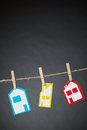 Three houses on a rope different types of hand drawn colorful paper held by clothespins line Royalty Free Stock Images