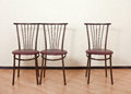 Three identical chair next against the wall Royalty Free Stock Photo