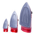 Three irons red of different sizes with grey bottoms standing vertically isolated on white Stock Photography