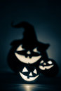 Three jack o lantern in blue at dark Stock Photo