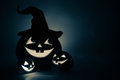 Three jack o lantern in blue at dark Stock Photos
