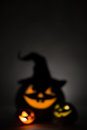 Three jack o lantern blurred background at dark Royalty Free Stock Photo