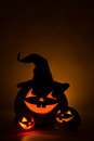 Three jack o lantern at dark Royalty Free Stock Photo