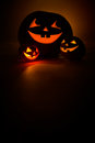 Three jack o lantern at dark Stock Image