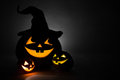 Three jack o lantern at dark Royalty Free Stock Photos