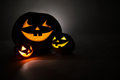 Three jack o lantern at dark Stock Photo