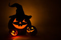 Three jack o lantern at dark Royalty Free Stock Images