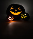 Three jack o lantern at dark Royalty Free Stock Image