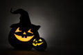 Three jack o lantern at dark Royalty Free Stock Photography