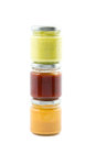 Three jars filled with sauces piled various Stock Photography