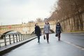 Three joyful girls walking in Paris Royalty Free Stock Photos
