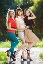 Three joyful women posing in the park Royalty Free Stock Image