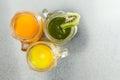 Three jugs of fresh tropical fruit juice Royalty Free Stock Photo