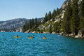 Three kayakers on Echo Lake in Sierra Nevada mountains, California, USA Royalty Free Stock Photo