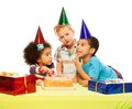 Three kids and birthday cake Royalty Free Stock Image