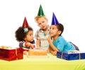 Three kids and birthday cake Royalty Free Stock Photo