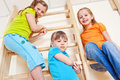 Three kids in bright clothing Royalty Free Stock Photo