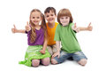 Three kids giving thumbs up sign Stock Image