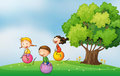 Three kids at hilltop playing with bouncing balls illustration of the the the Stock Photo