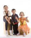 Three kids laughing Stock Images